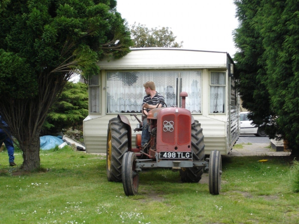 Photo of static caravan being pulled by tractor