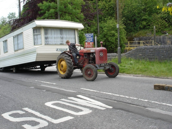 Photo of caravan off truck, hitched up to tractor