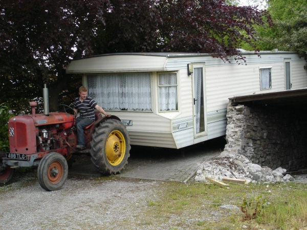 Photo of static caravan being inched through narrow driveway