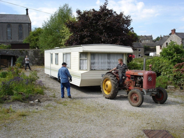 Photo of static caravan being reversed into position by tractor